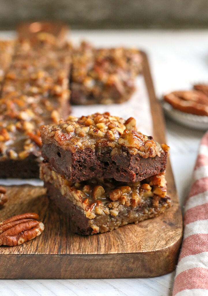 a stack of two paleo pecan praline brownies