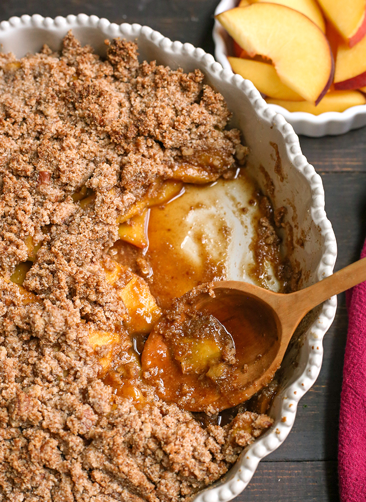 vegan paleo peach crisp in a pie plate