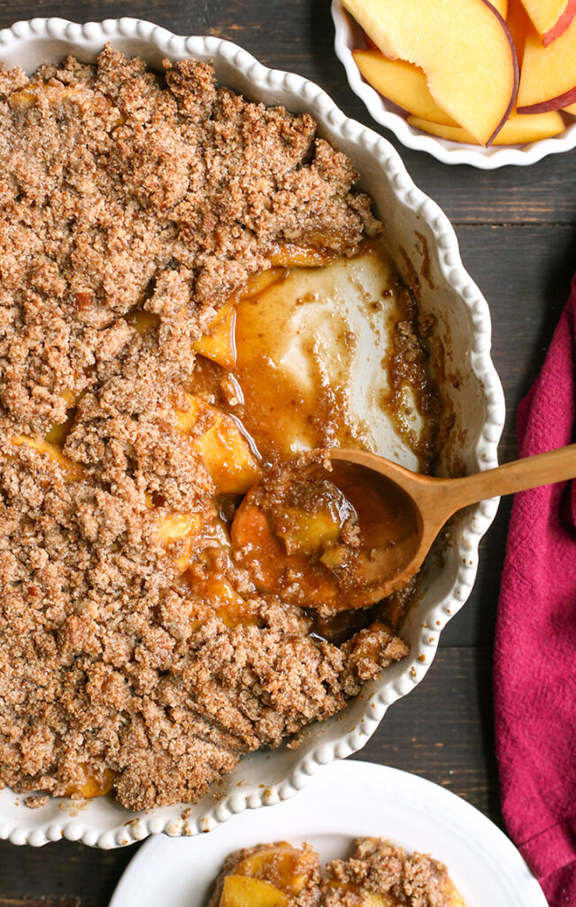 paleo peach crisp with a spoonful taken out