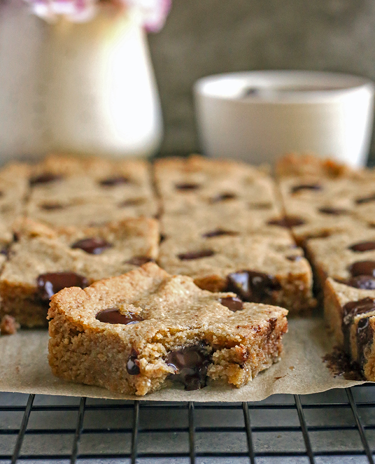 grain free brown butter blondies with a bite taken out of one