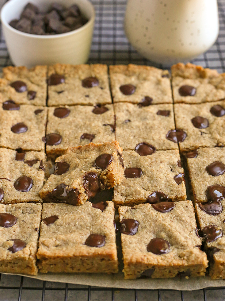 grain free brown butter blondies, cut with a bite out of one