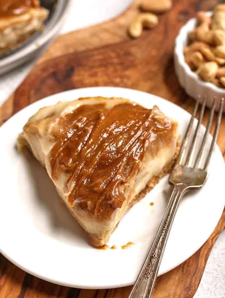 a slice of paleo vegan cinnamon roll cheesecake