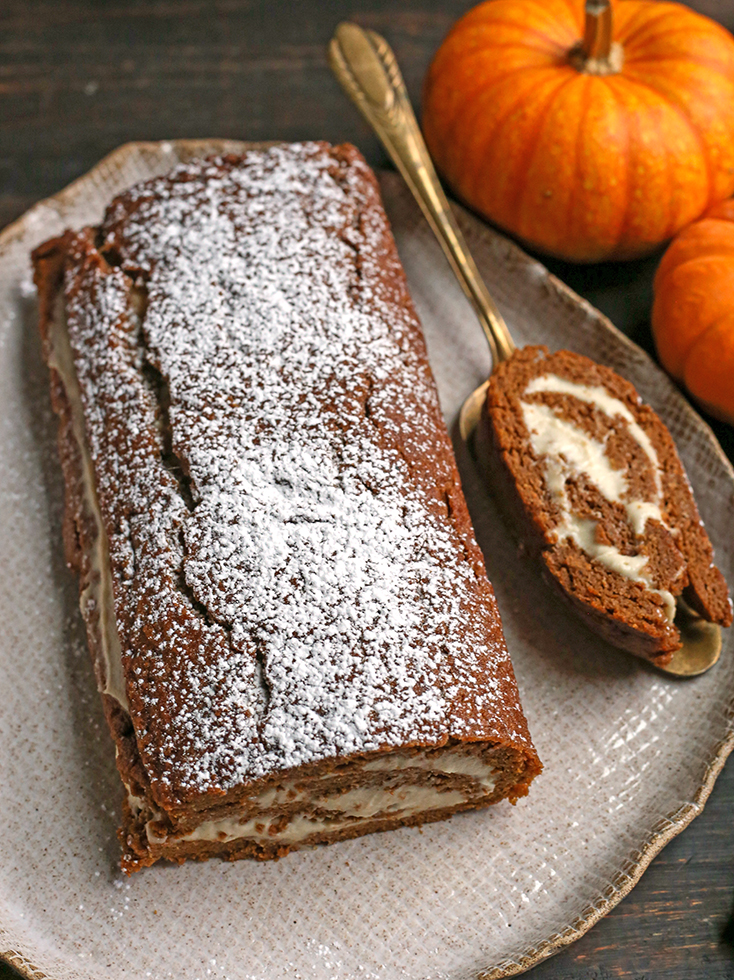 the whole paleo pumpkin roll with one slice cut out