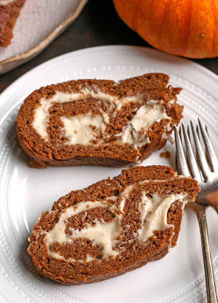 two slices of paleo pumpkin roll, showing the filling