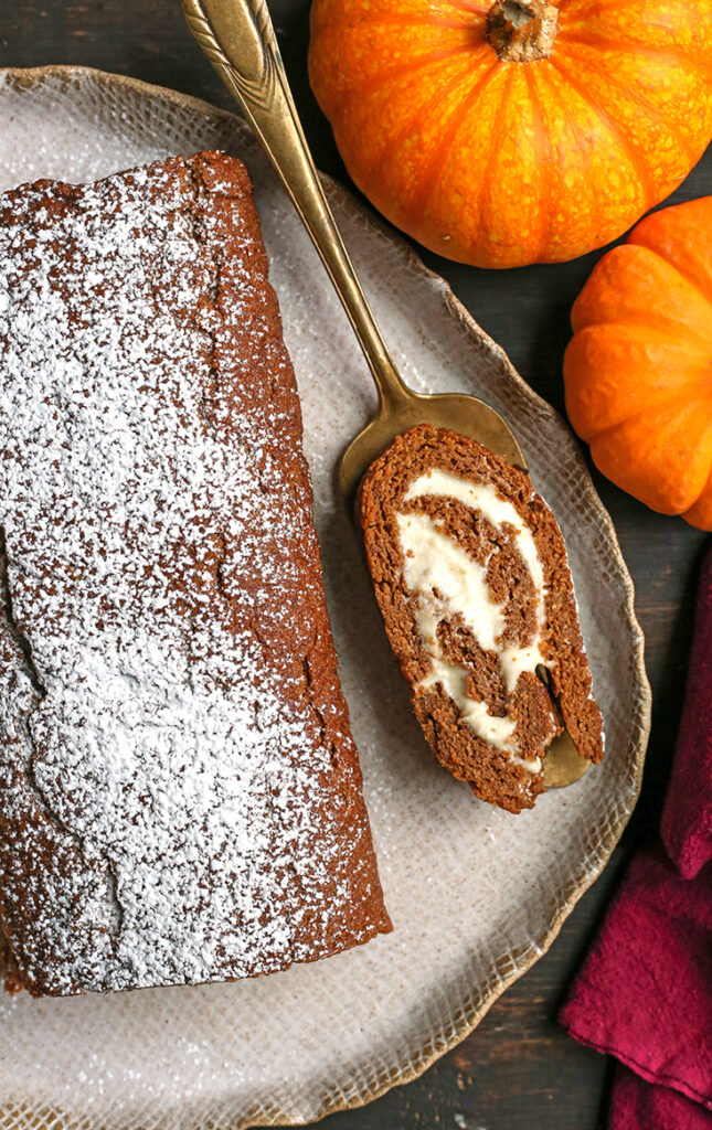 a slice of paleo pumpkin roll on a pie server