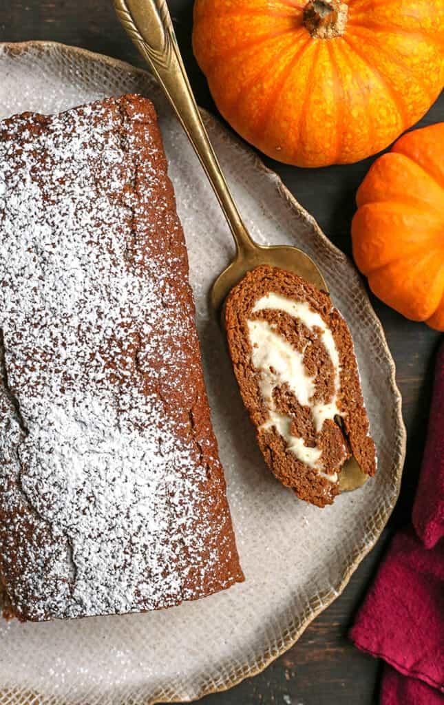 a slice of paleo pumpkin roll on a pie server