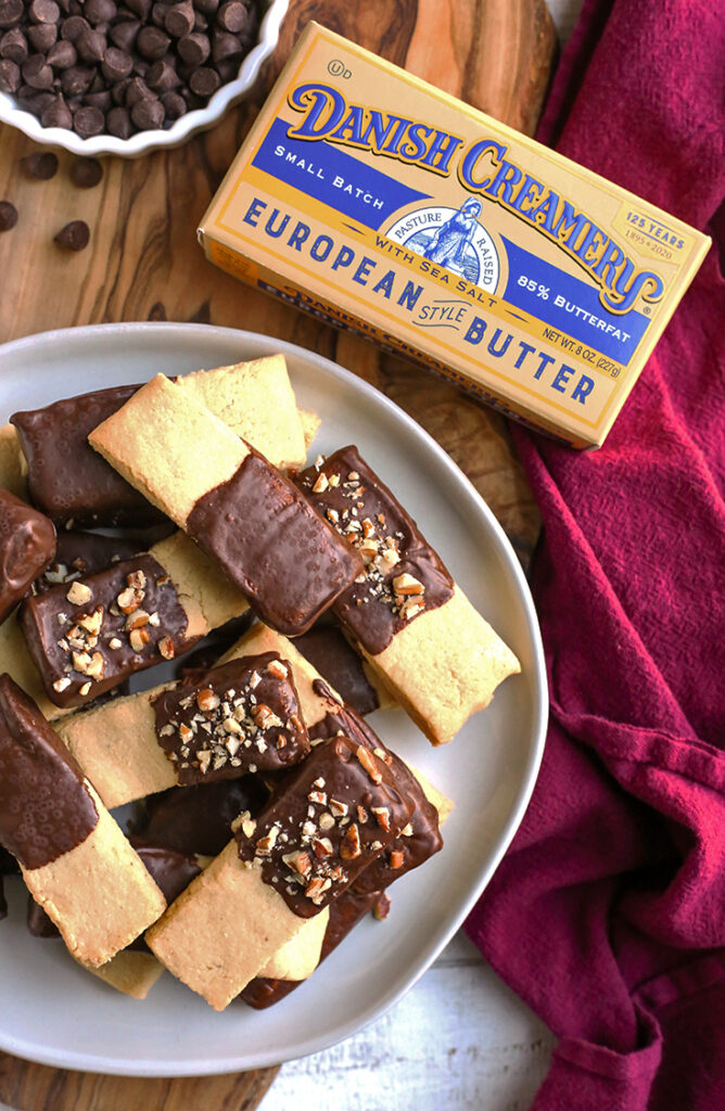 a plate of chocolate dipped grain free shortbread cookies
