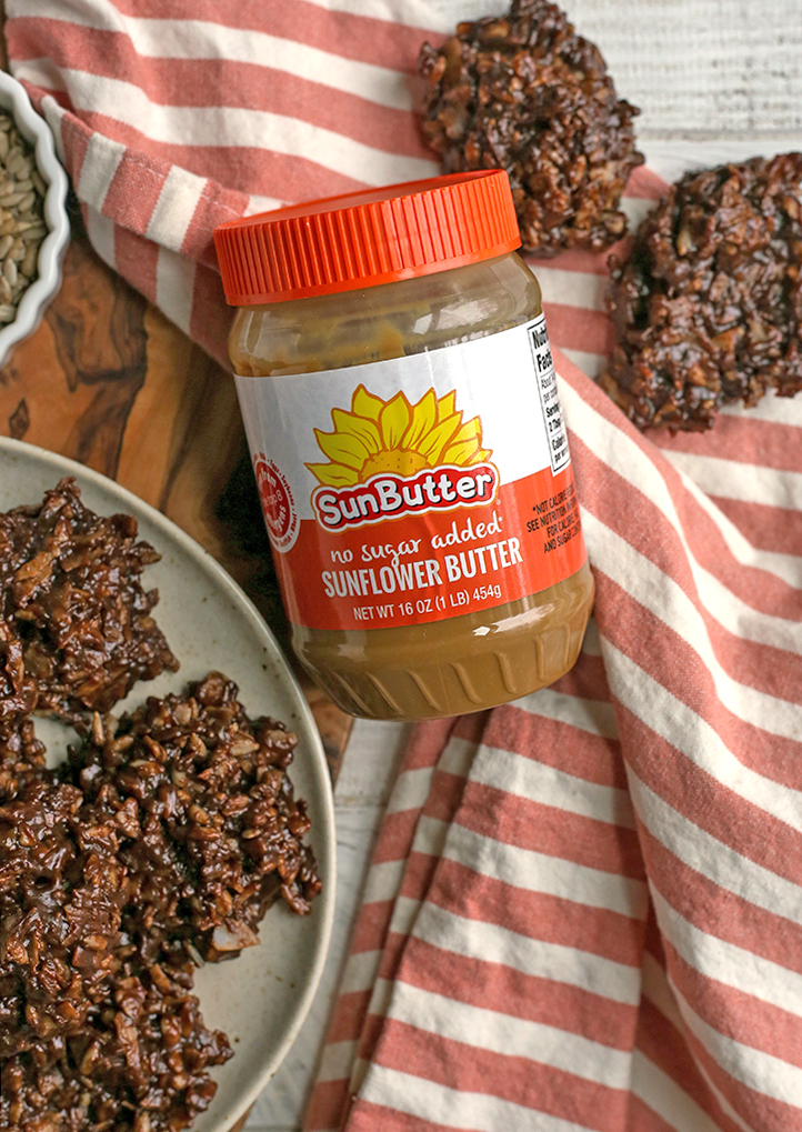 paleo nut free no bakes with a jar of sunbutter