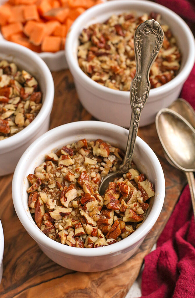 paleo sweet potato pecan dessert cups, with a spoon in one