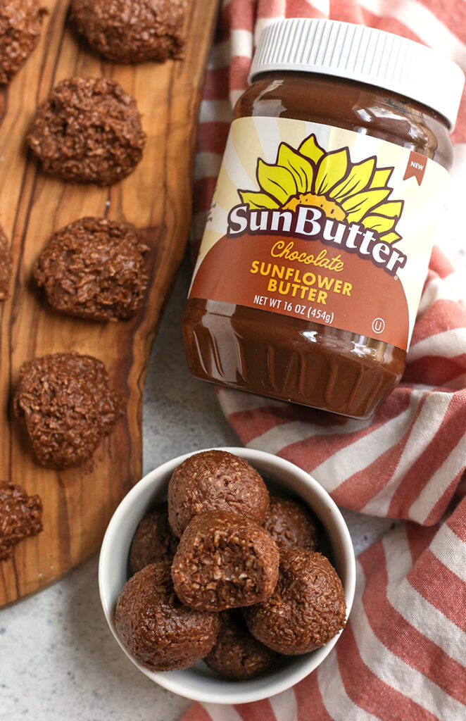 paleo nut free chocolate coconut bites in a bowl and on a cutting board