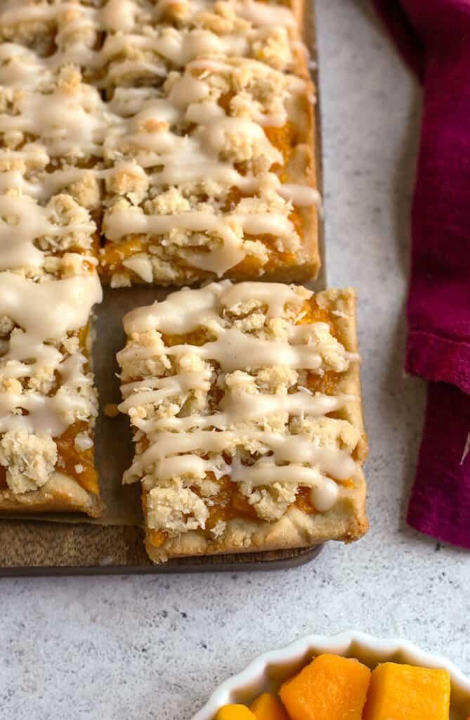 top view of paleo vegan mango crumb bars the shows the crumb and glaze