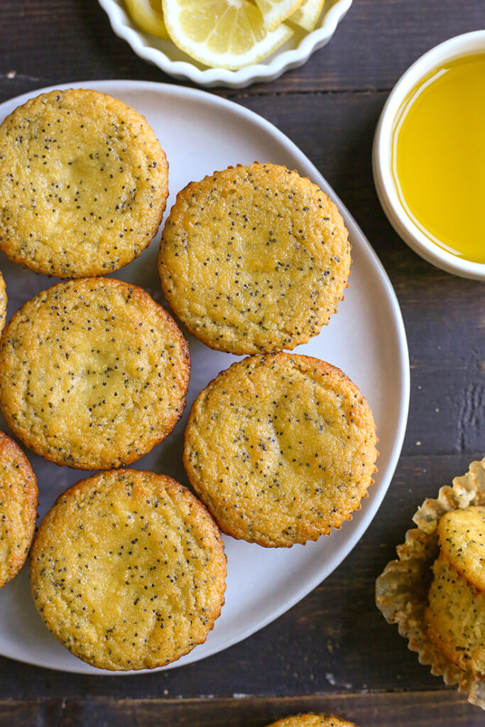 top view of a plate of paleo lemon poppy seed muffins without glaze