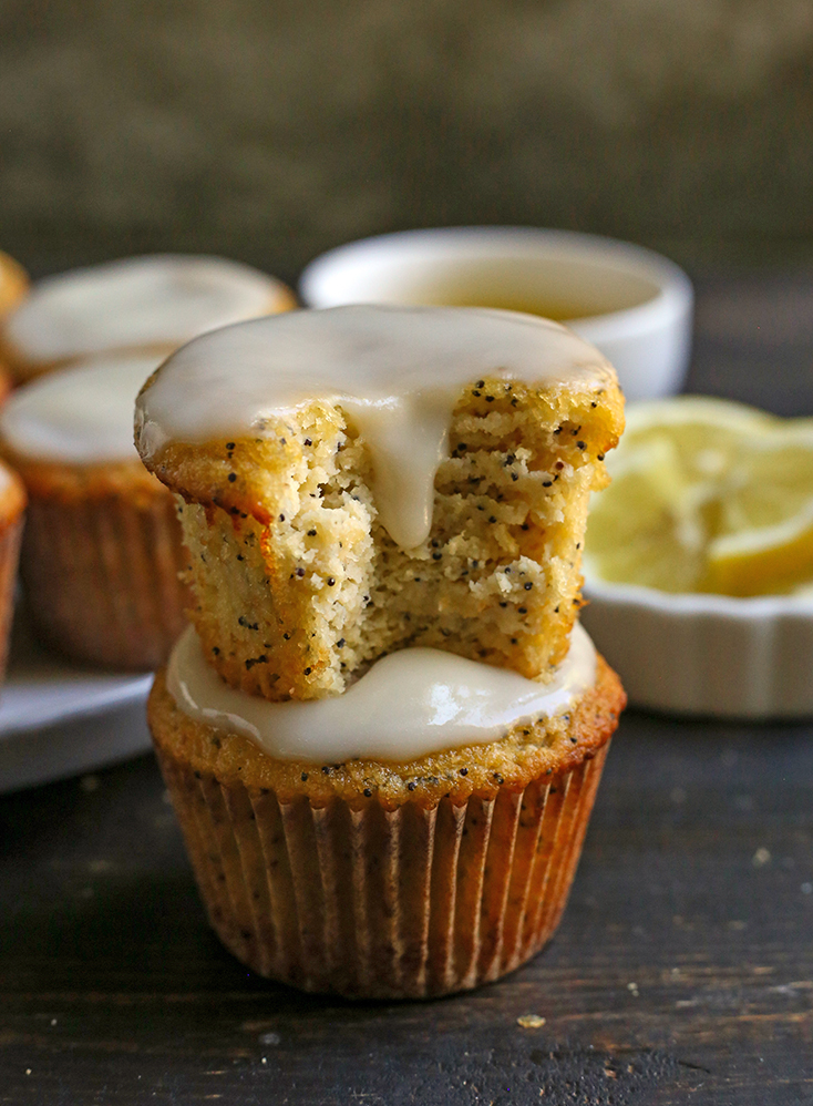 a stack of two lemon poppy seed muffins with glaze