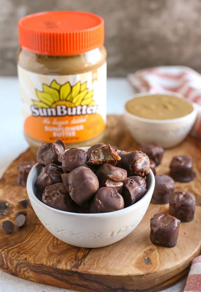 paleo vegan rolos in a small bowl on a cutting board