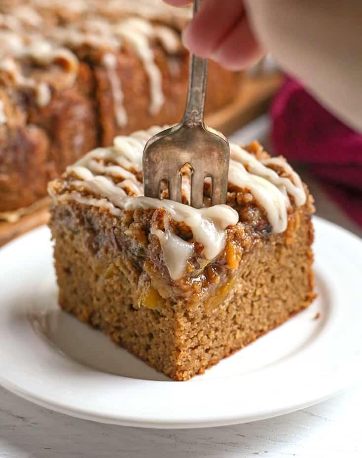 a fork taking a bite of paleo peach cobbler coffee cake