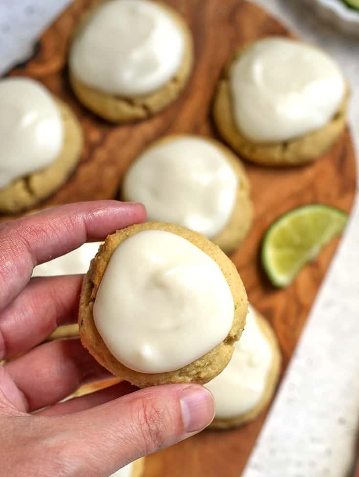 a hand holding a paleo soft lime cookie