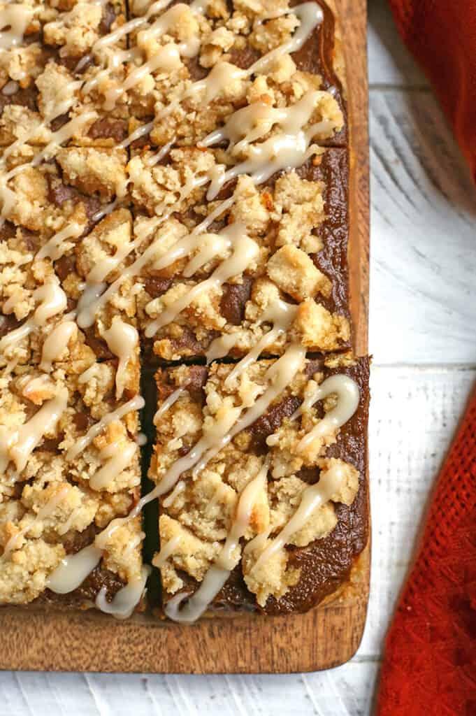cutting board with paleo pumpkin pie crumb bars on it